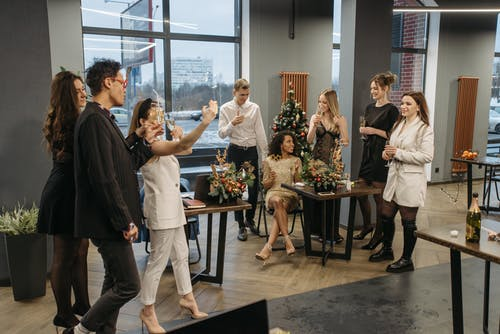 People Having A Christmas Party In The Office