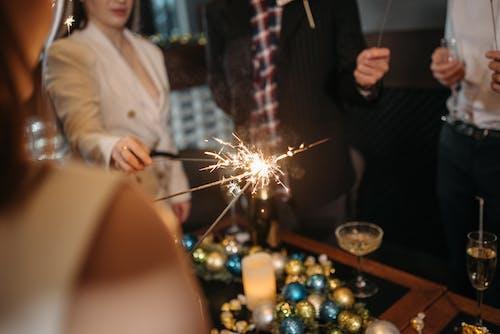 People Lighting Up Sparklers