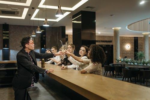 A Team Having a Celebration at a Bar