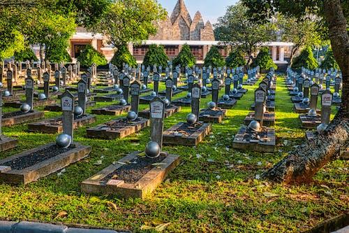 Gravestones with hardhats in heroes cemetery