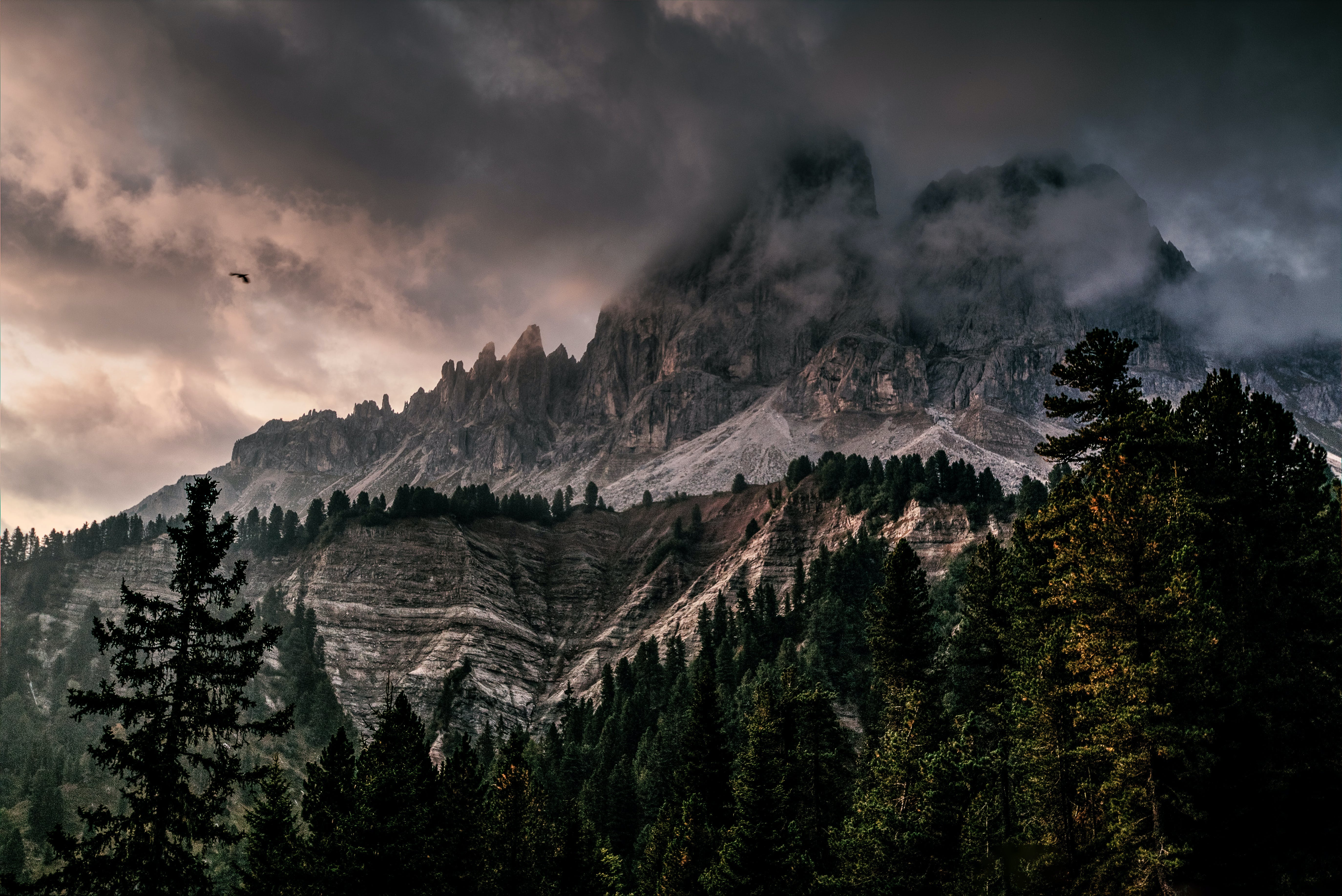Photo of Mountain With Ice Covered With Black and Gray Cloud