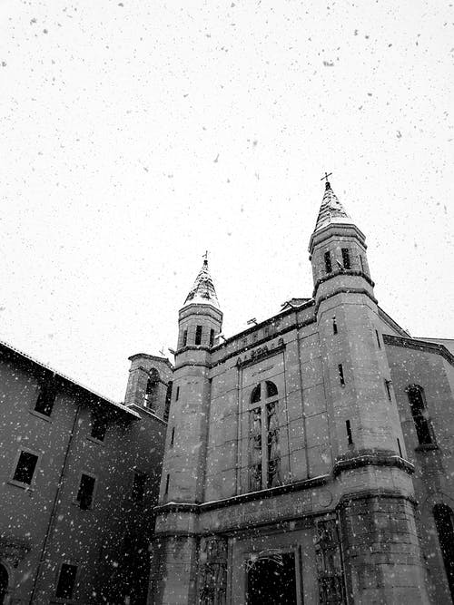Medieval Roman Catholic cathedral exterior during snowfall