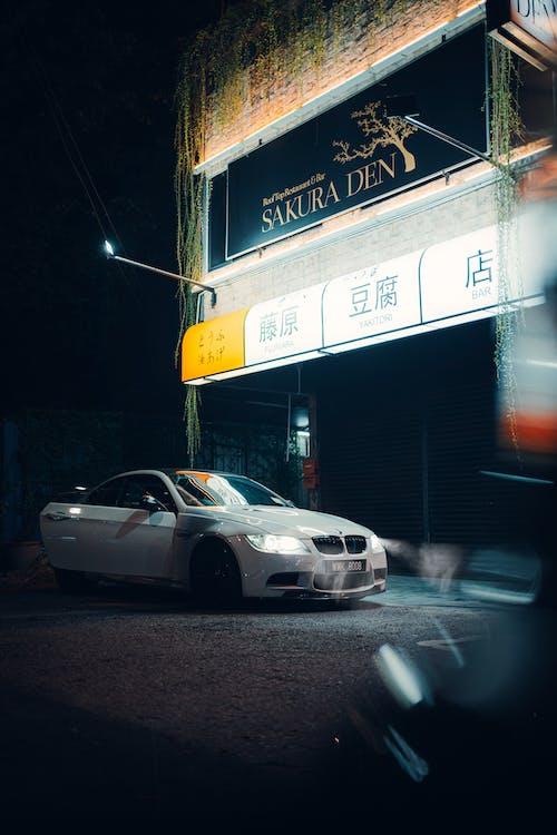 White Sedan on Road during Night Time