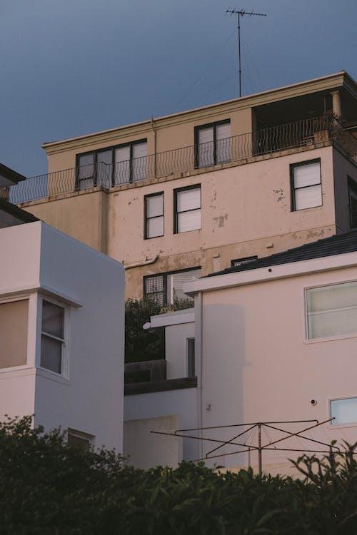 Residential buildings exteriors under blue sky
