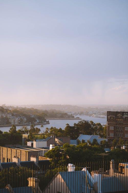 Residential houses located near sea under sundown sky in town