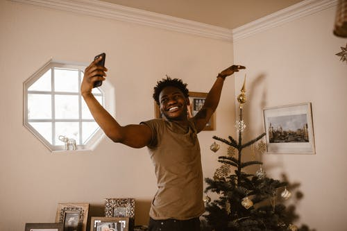 Smiling Man Having a Video Call Using a Cellphone