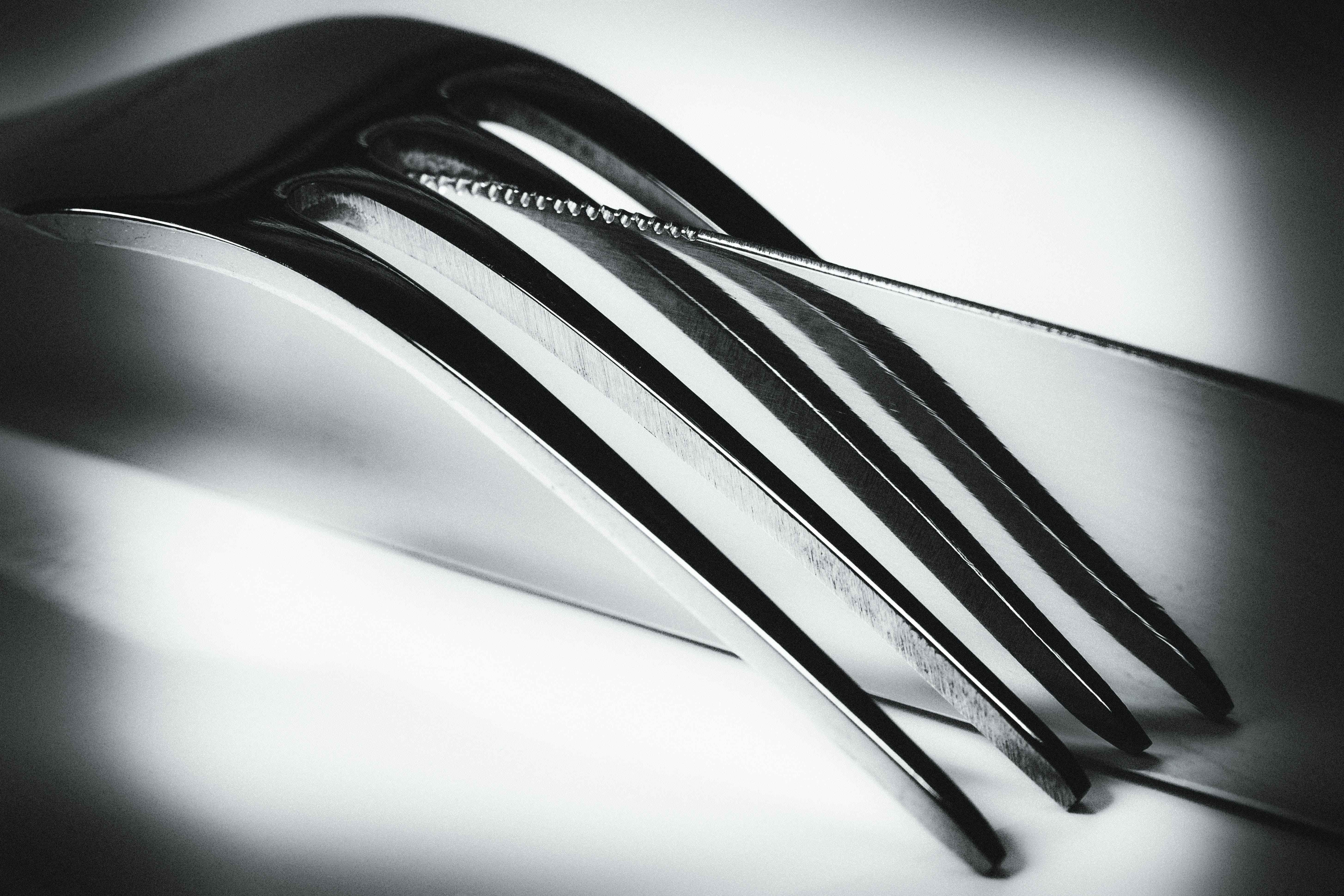 Silver Metal Fork on Top of a Silver Butter Knife