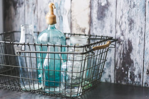 Vintage empty bottles in metal basket