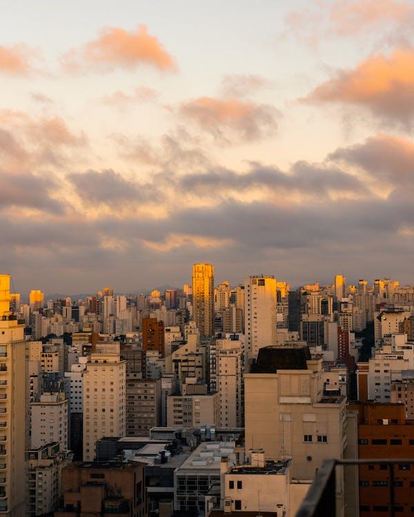 City Skyline Under Cloudy Sky
