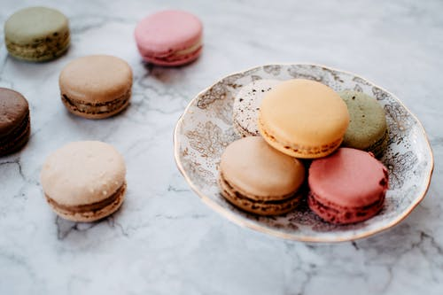 Macaroons over a Marble Top Table