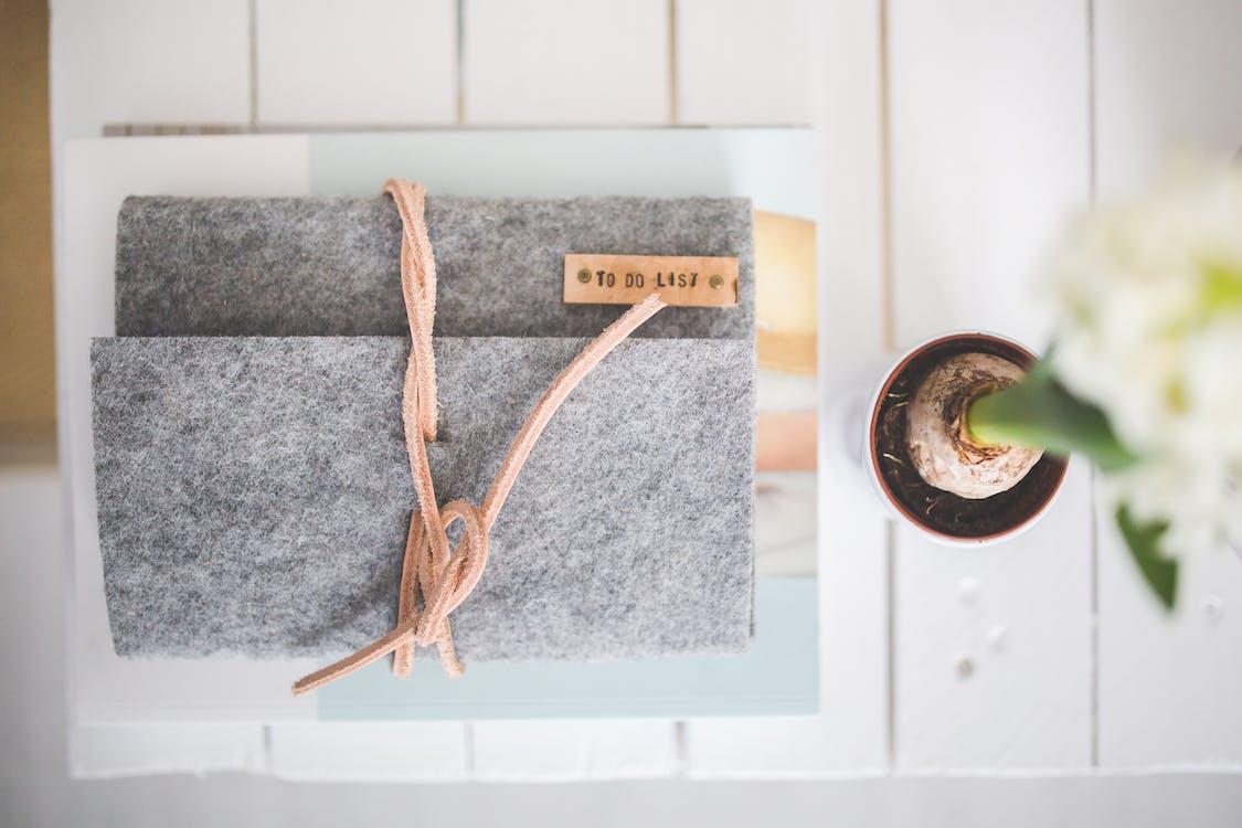 Grey Felt Journal TO DO LIST on a white desk