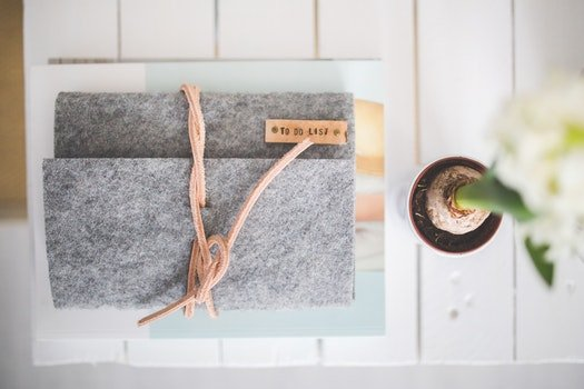 Grey Felt Journal TO DO LIST on a white desk