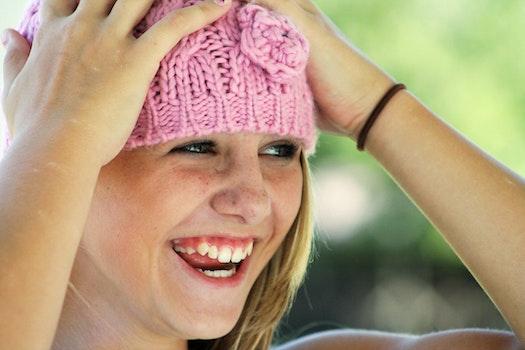Woman Wearing Pink Knit Cap