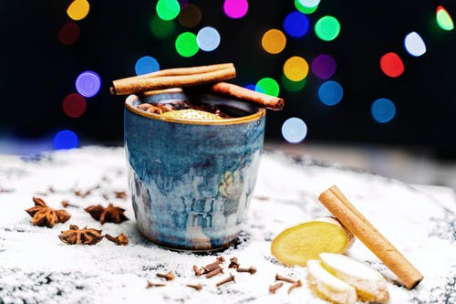 Ginger Tea With Cinnamon And Star Anise On Blue Ceramic Cup
