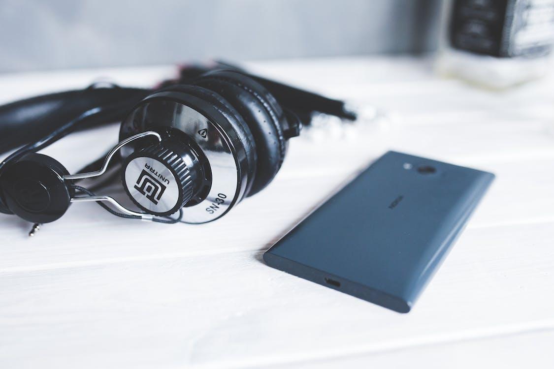 Closeup of headphones with smart phone II