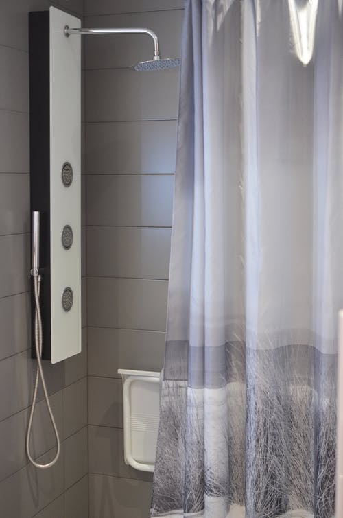 Modern bathroom with shower cabin and curtain