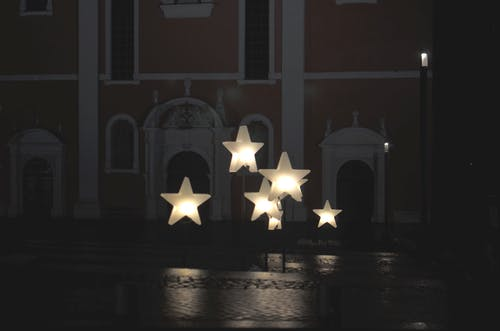 Star shaped decoration on street of aged city in evening