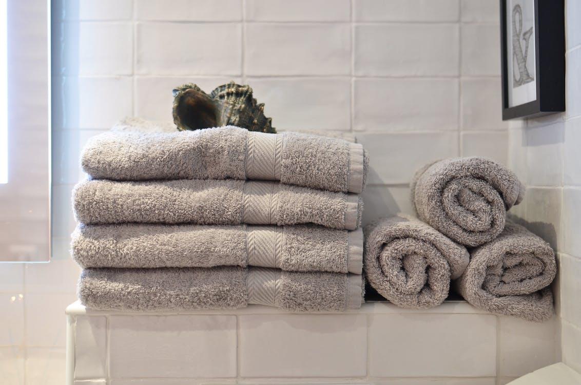 Stack of towels in minimalist bathroom