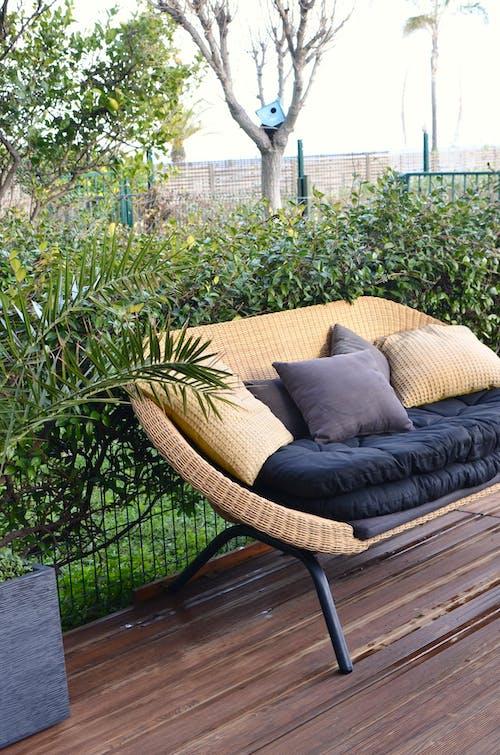 Stylish wicker sofa placed in patio