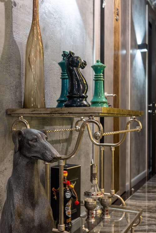 Dog and chessmen statuettes in house room