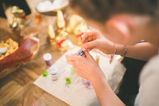 Close up of girl hands coloring eggs for easter II