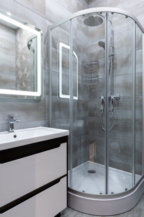 Contemporary shower room interior with washstand in house