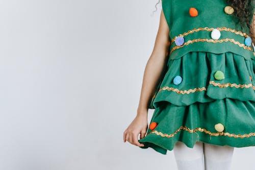Crop girl in Christmas tree costume
