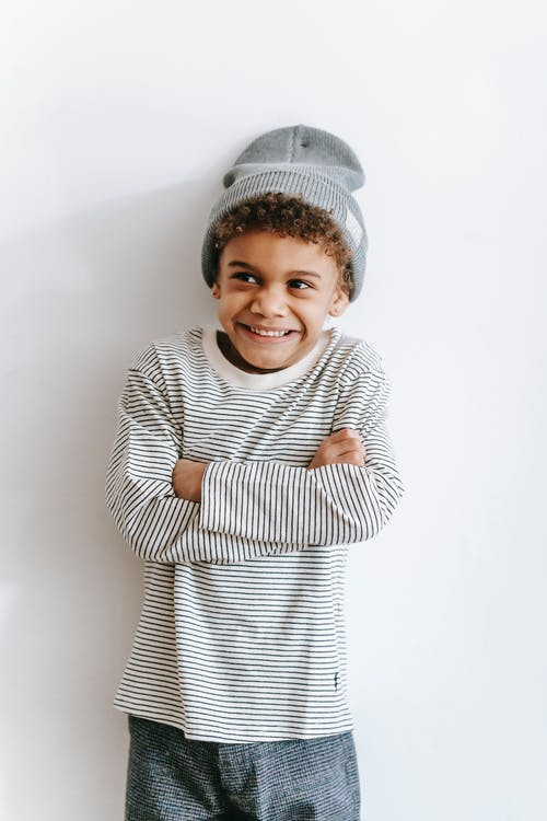 Cute cheerful kid smiling against white background