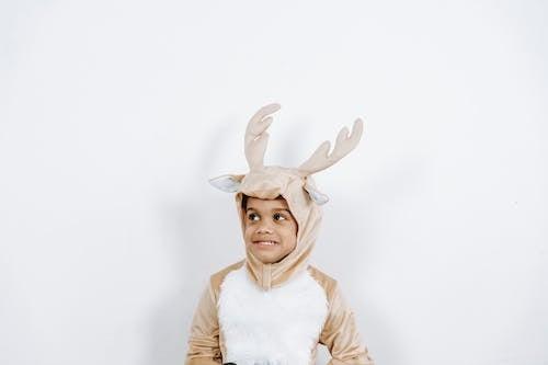 Adorable little black boy in soft reindeer costume