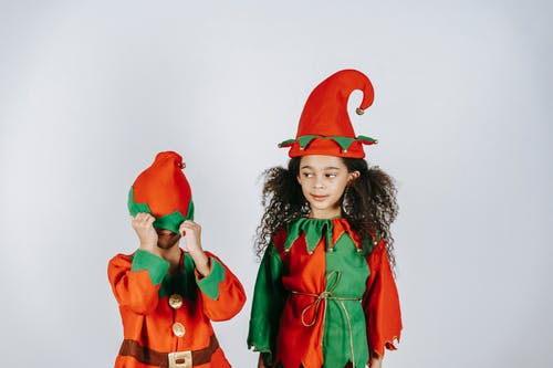 Cute black children in costumes of elves playing