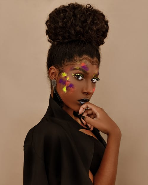 Black woman with painted colorful face