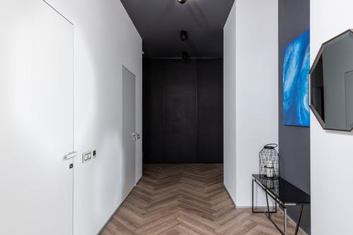 Modern corridor with doors and decorations