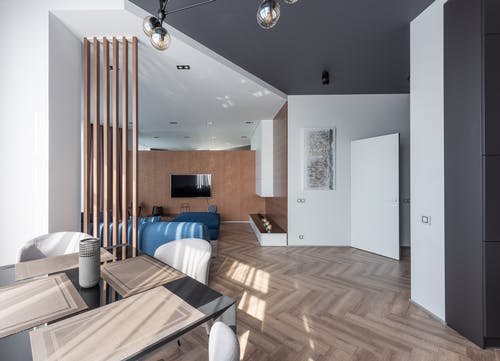 Modern apartment with table near living room