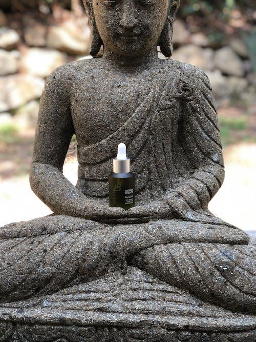 Black Glass Bottle on Man Statue