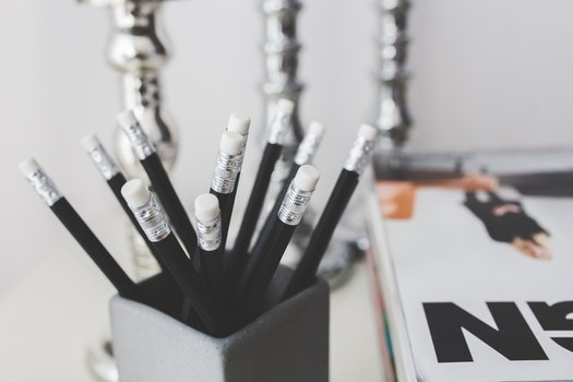 Black pencils with white erasers