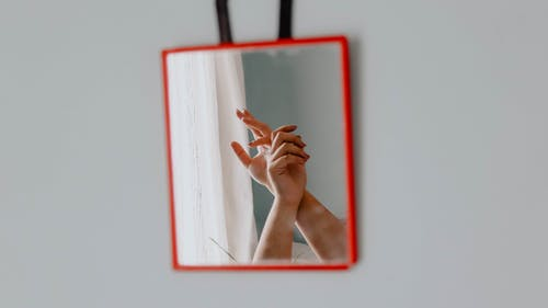 Person Holding Red and White Frame