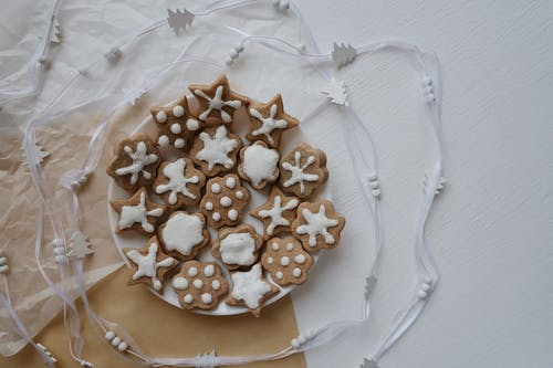 Brown and White Round Cookies on Clear Glass Plate