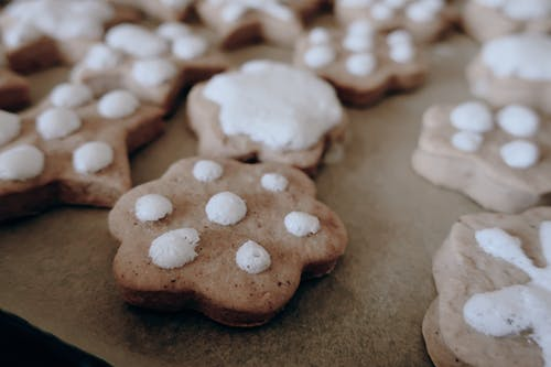 White and Brown Cookies on Brown Wooden Table
