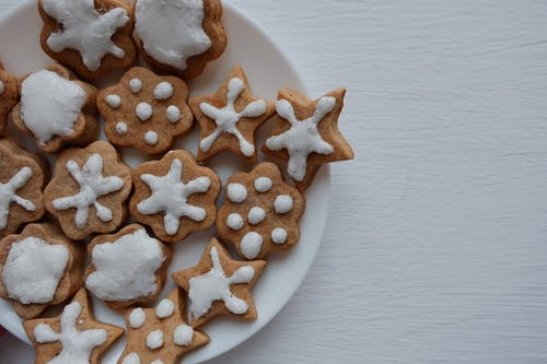 White and Brown Heart Shaped Cookies on White Ceramic Plate