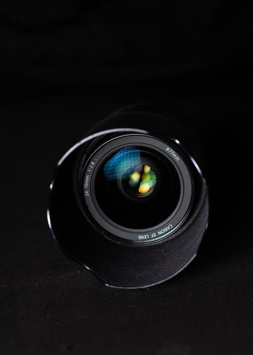 Black Camera Lens on Black Textile