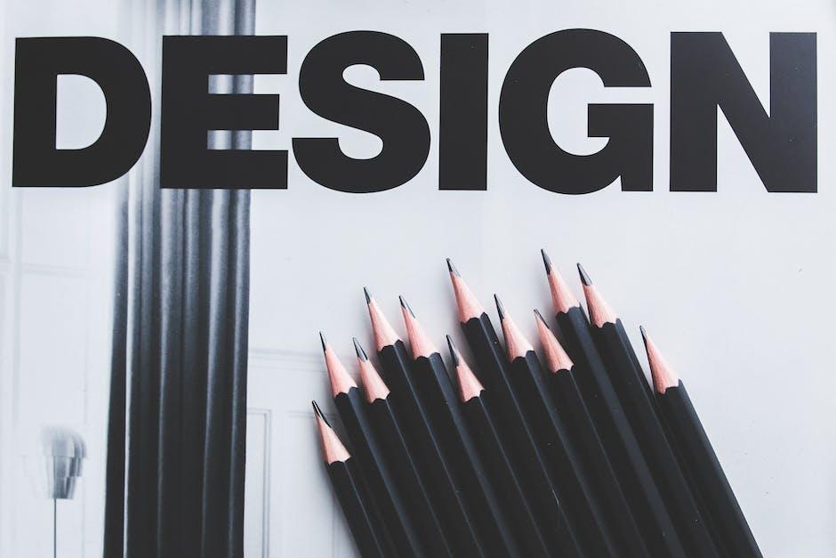 Black pencils and Design word