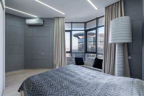 Modern bedroom with big window