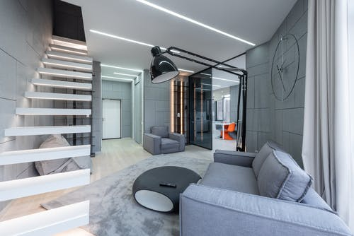 Apartment with steps near couch with table and lamp