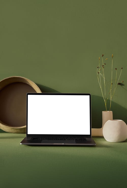 Laptop with blank screen placed on table