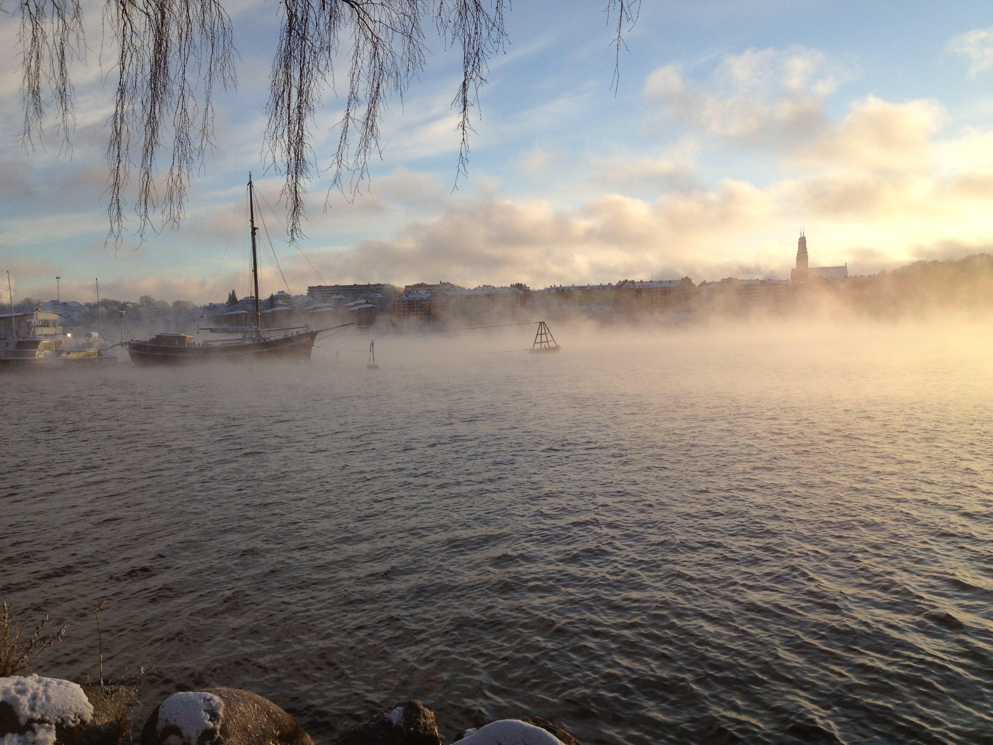 Free stock photo of boats, church, fog, sun