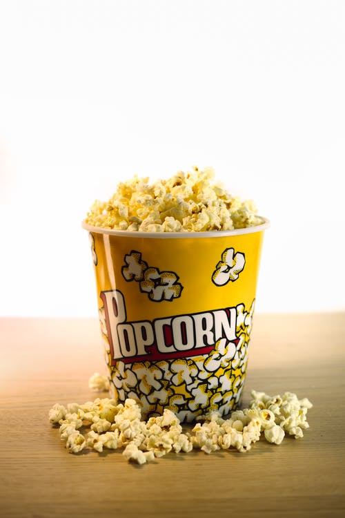 Popcorn in White and Blue Plastic Cup