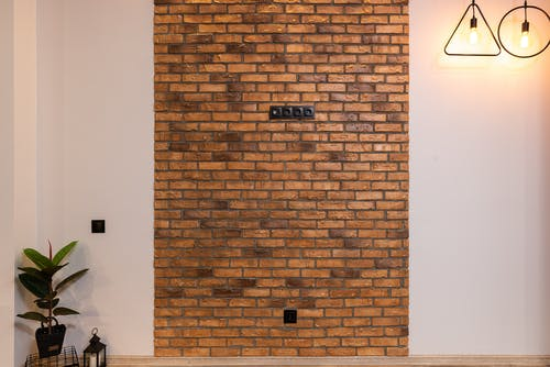 Interior of modern apartment with brick wall