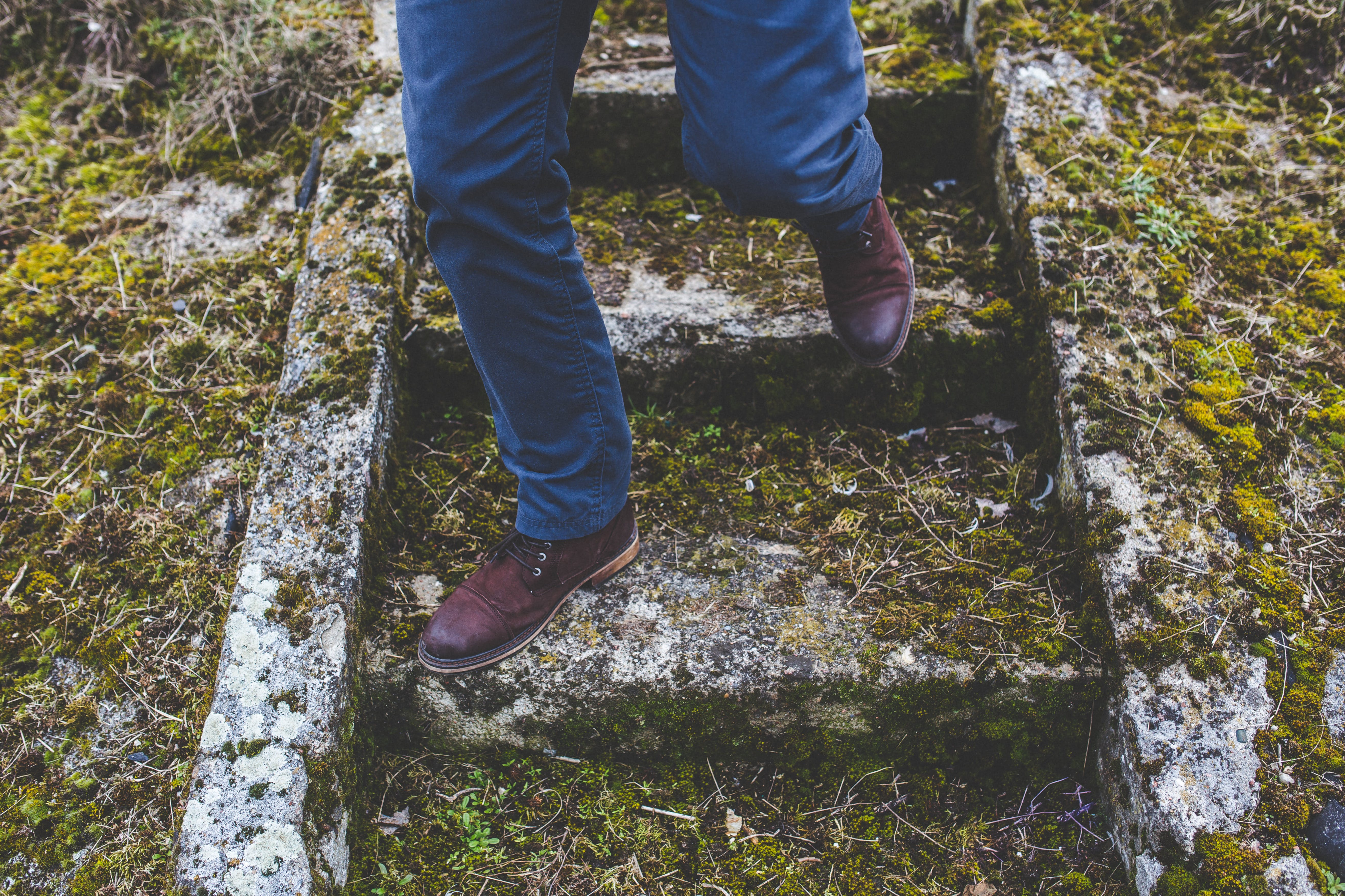Man walking down the old stone staircase