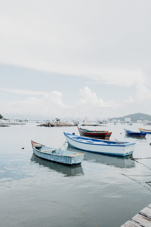 Boats Docked on the Sea