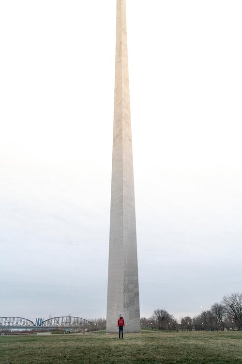 A Person Standing in Front of the Gateway Arch in St. Louis